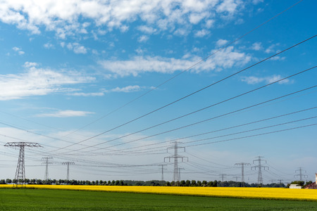High-voltage power lines in an agricultural area lakes in Germany