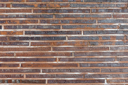 Background from small red clinker bricks Stock Photo
