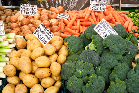 Broccoli, potatoes and other vegetables for sale at a market