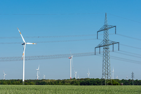Overhead power line and wind turbines seen in rural Germany