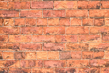 Background from an old and rugged orange brick wall