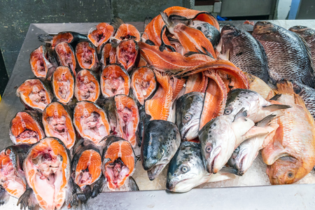 Parts of salmons for sale at a market