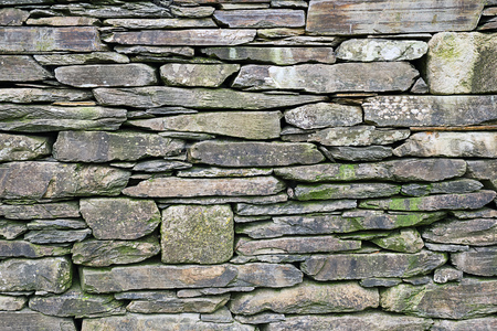 Background from an old natural stone wall Stock Photo
