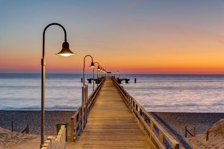 Long pier at the german baltic sea coast before sunrise