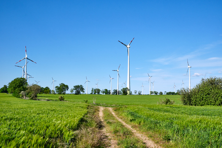 Wind turbines at an agricultural area lakes in Germany Archivio Fotografico