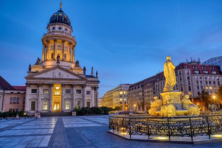 The French Cathedral and the Schiller Monument at the Gendarmenmarkt in Berlin at dawn Banco de Imagens