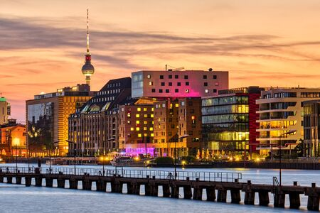 Dramatic sunset on the River Spree in Berlin with the Television Tower in the back 版權商用圖片