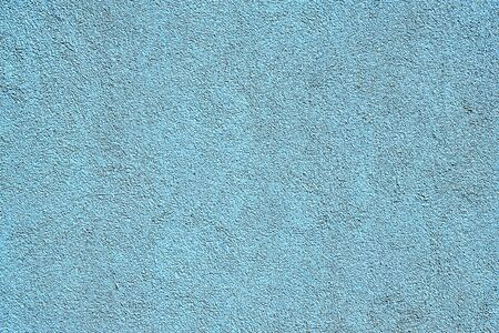 A textured background from light blue plaster
