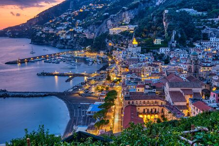 View of Amalfi after sunset on the coast of the same name in Italy