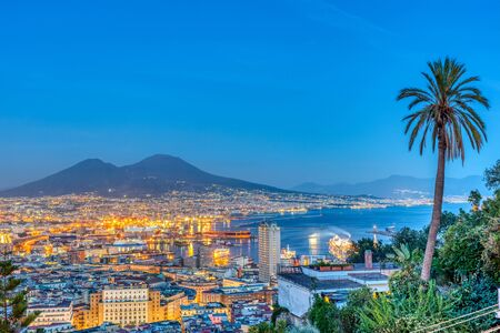 Naples in Italy with Mount Vesuvius at dusk