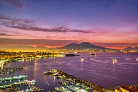Dramatic sunrise in Naples with mount Vesuvius in the back