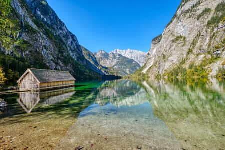 The lovely Obersee in the Bavarian Alps with a wooden boathouse Archivio Fotografico