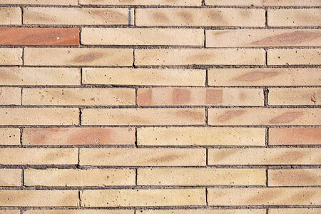 Background from a wall of beige clinker bricks