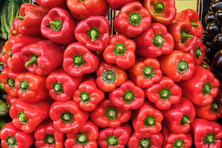 Pile of red bell pepper for sale at a market