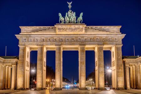 The illuminated Brandenburg Gate in Berlin at night with no people