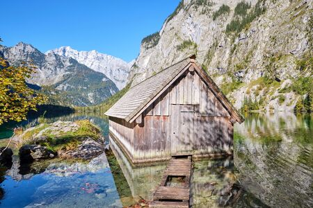The beautiful Obersee in the Bavarian Alps with a wooden boathouse