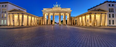 Panorama of the illuminated Brandenburg Gate in Berlin after sunset with no people