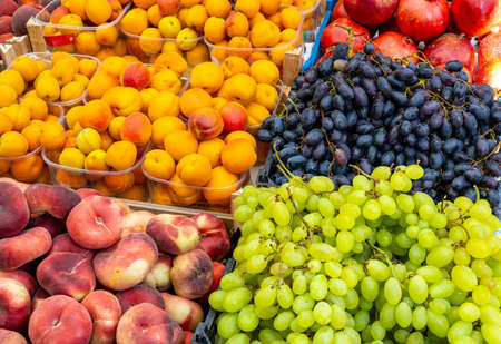 Grapes, peaches and plums for sale at a market