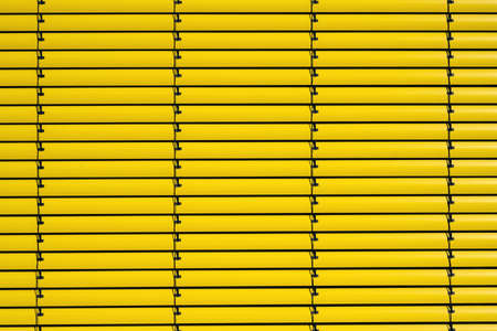 Background from yellow metal blinds