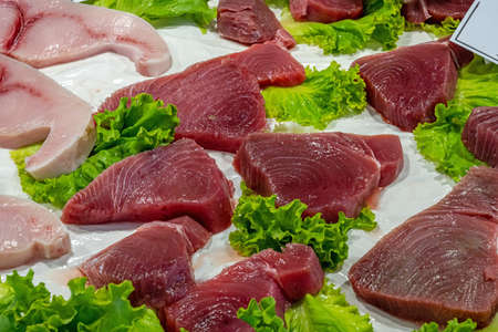 Fresh tuna steaks for sale at a market