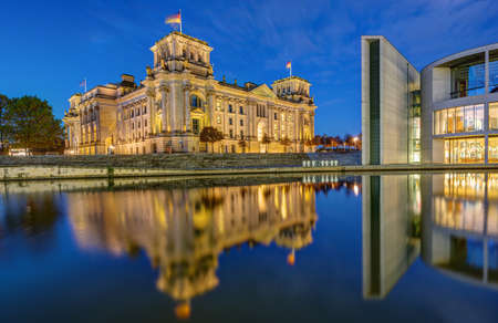 The Reichstag and part of the Paul-Loebe-Haus at the river Spree in Berlin at dawn