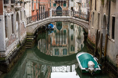 Tranquil scene in one of the small canals in the old town of Venice, Italy