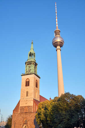 The famous Television Tower and the Marienkirche at the Alexanderplatz in Berlin