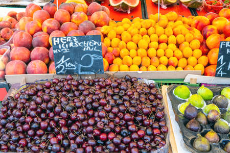 Cherries, plums and other fruits for sale a market