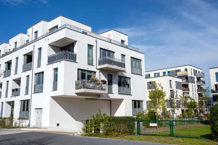 Modern white townhouses in a development area in Berlin, Germany