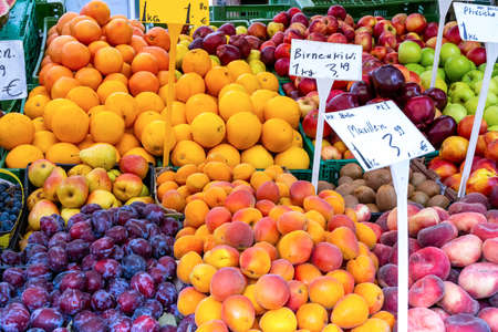 Oranges, plums and other fruits for sale at a market