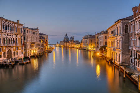The Grand Canal and the Basilica Di Santa Maria Della Salute in Venice before sunrise Imagens