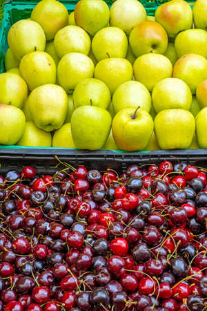 Cherries and apples for sale at a market