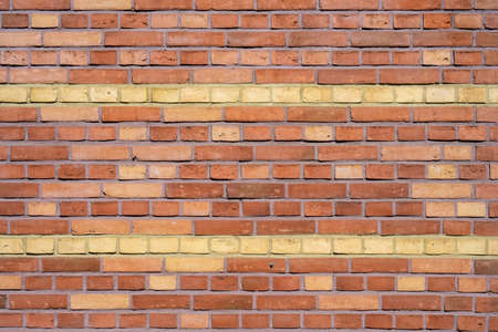 Background from a red brick wall with yellow stripes Imagens