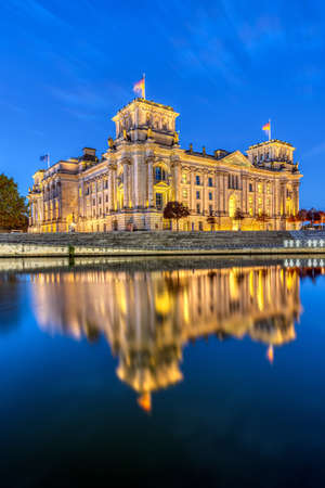 The Reichstag at the river Spree in Berlin at dawn Editorial