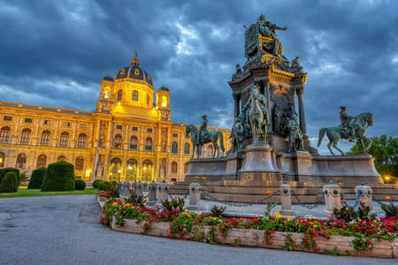 The Natural History Museum with the statue of Maria Theresa in Vienna, Austria, at twilight Editorial