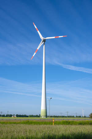 Wind turbine in front of a blue sky in Germany