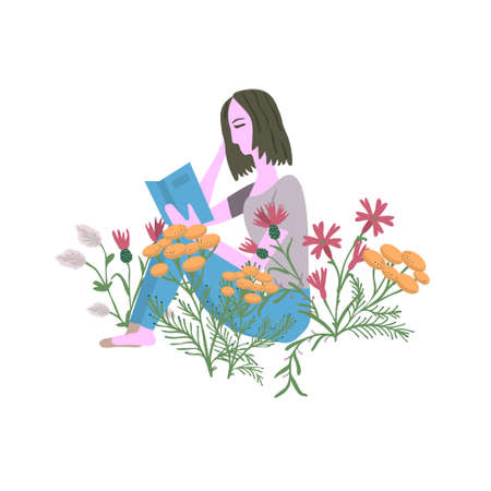 girl reading a book in the meadow