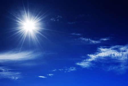Sun shinning in a deep blue sky Stock Photo