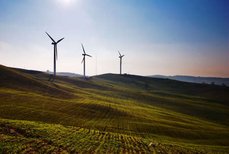 Three wind turbines silhouettes on top of hill Stock Photo - 2910436
