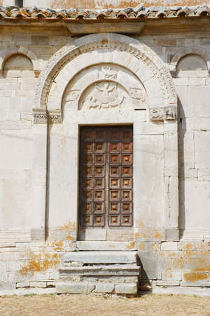 molise: The ancient door of a medieval church (Santa Maria della Strada, molise,center Italy) Stock Photo