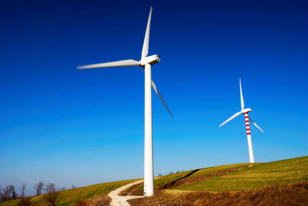 Two modern and ecologic generators on top of a hill Stock Photo - 2938047