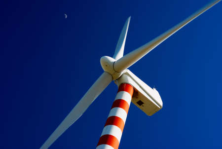 Wind turbine with deep blue sky and moon Stock Photo - 2985964
