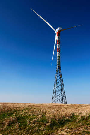 Solitary wind turbine in a field under clear blue sky Stock Photo - 3117416