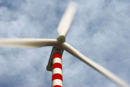 Moving Wind Turbine Under Cloudy Sky Stock Photo - 3180419