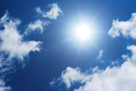 ultraviolet: Sun shinning in a blue and white sky