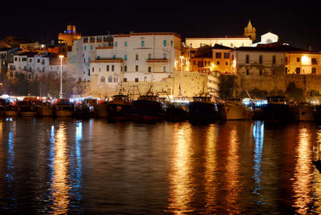 Old town of Termoli with its harbor by night Stock Photo