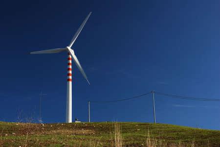 Modern and ecologic eolic generator on hill Stock Photo - 3538368