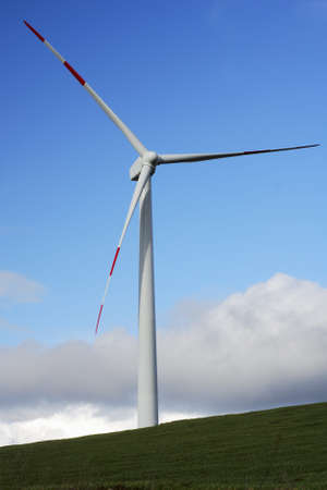 Modern and ecologic wind turbine and blue sky Stock Photo - 4270743