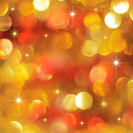 Christmas golden and red lights background with little stars Stock Photo