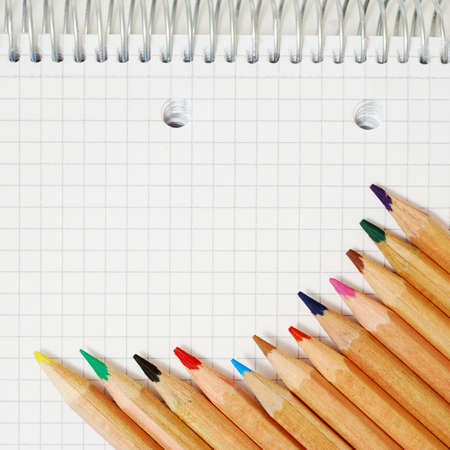 Color pencils and white notes paper photo